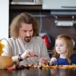 Father and his kid making chestnuts creatures — Stock Photo