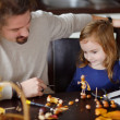 Father and his kid making chestnuts creatures — Stock Photo #43463371