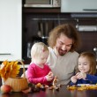 Father and his kids making chestnuts creatures — Stock Photo #43463477