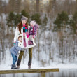Young mother and her daughters at winter day — Stock Photo #43463537