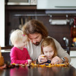 Father and his kids making chestnuts creatures — Stock Photo