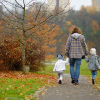 Father and kids taking a walk on autumn day — Stock Photo #43463707