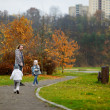 Father and kids taking a walk on autumn day — Stock Photo #43464163