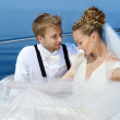 Happy bride and groom on a yacht — Stock Photo #43465255