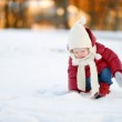 Toddler girl having fun on winter day — Stock Photo #43466071