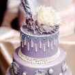 Purple wedding cake decorated with flowers — Stock Photo #43466929