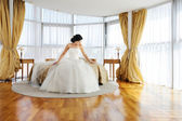 Beautiful bride in a hotel room — Stock Photo