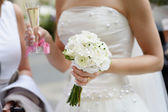 Bride is holding a wedding bouquet — Stock Photo