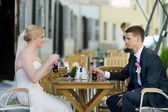 Bride and groom having a refreshing drink — Stock Photo