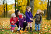 Happy family on beautiful autumn day — Photo