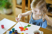 Cute girl is drawing with paints in preschool — 图库照片
