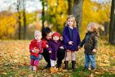 Happy family on beautiful autumn day — Stock Photo