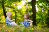Two sisters portrait outdoors — Stock Photo