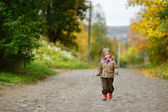Adorable girl having fun on autumn day — Foto Stock