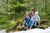 Young mother and her two daughters outdoors — Stock Photo