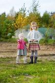 Two girls celebrating sister's first birthday — Foto de Stock