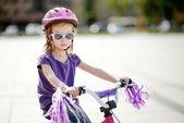 Adorable girl riding a bike — 图库照片