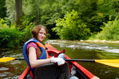 Young woman on a kayak — Stock Photo