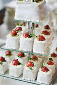 Delicious fancy wedding cake made of cupcakes — Stock Photo
