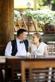 Bride and groom having fun at cafe — Stock Photo