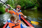 Young father and a child on a kayak — Stock Photo