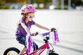 Adorable girl riding a bike — Stock Photo
