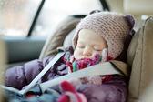 Sweet toddler girl sleeping in a car seat — Stock Photo