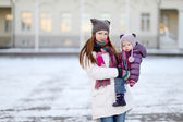 Young mother and her daughter at winter day — Stock Photo