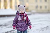 Little girl portrait on winter day in city — Stock Photo