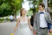 Happy bride and groom enjoying themselves — Stock Photo