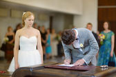 Groom signing a wedding contract — Stock Photo