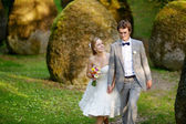 Happy bride and groom enjoying themselves — Foto Stock
