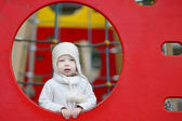 Adorable toddler girl on a playground — Stock Photo