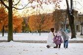 Young mother and her kids having fun in winter — Stock Photo