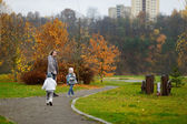 Father and kids taking a walk on autumn day — Foto de Stock