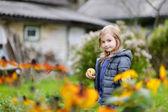 Little girl's portrait outside on an autumn day — Stock Photo