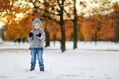 Little girl having fun on winter day — Stock Photo