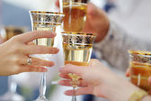 People holding wine glasses at festive event — Stock Photo
