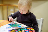 Cute toddler girl drawing with paints in preschool — Stock Photo