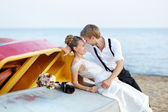 Bride and groom hugging on a beach — Stock Photo