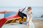 Bride and groom kissing on a beach — Stock Photo