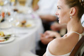 Bride at the reception table — Stock Photo