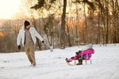 Father and his daughters having fun on winter day — Stockfoto