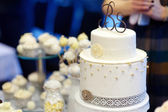 White wedding cake decorated with white lace — Stockfoto