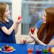 Mother and her daughter painting Easter eggs — Stock Photo #43481465