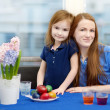Mother and her daughter painting Easter eggs — Stock Photo