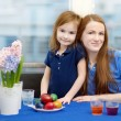 Mother and her daughter painting Easter eggs — Stock Photo #43481451