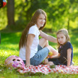 Young mother and her daughter having a picnic — Stock Photo #43481985