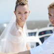 Happy bride and groom on a yacht — Stock Photo #43483937