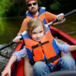 Little girl and her father on a kayak — Stock Photo #43484725